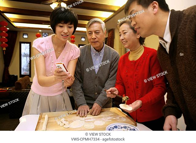 Chinese family making Chinese dumpling on New Year's Eve
