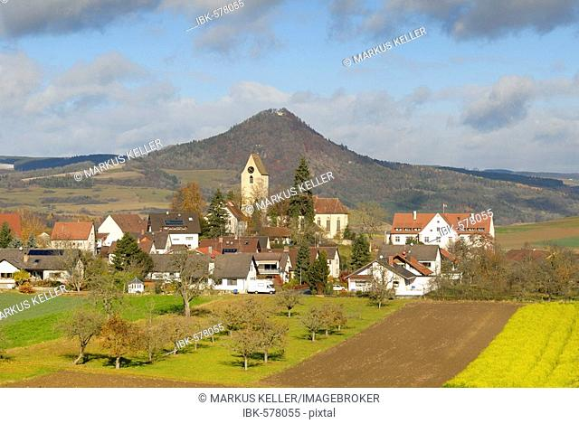 The village of Weiterdingen and the volcanic rock hohenhewen - Baden Wuerttemberg, Germany, Europe