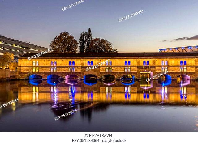 Evening view of the Barrage Vauban, or Vauban Dam, is a bridge, weir and defensive work erected in the 17th century on the River Ill in the city of Strasbourg...