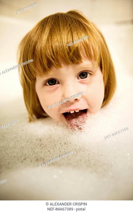 A girl in a foam bath