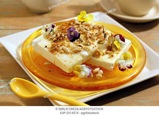 Soft cheese with honey and nuts
