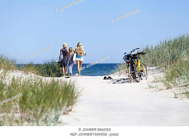 Mother with daughters looking at sea, Oland, Sweden