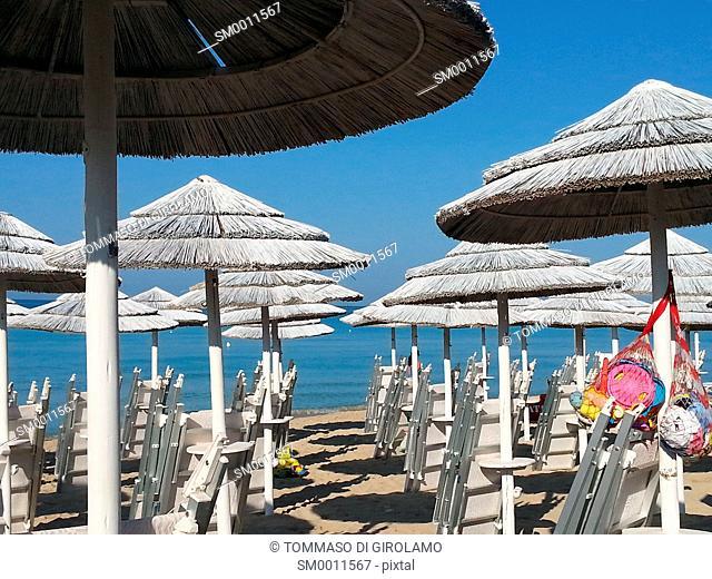 Italy, Salento, Apulia, porto cesareo, Lapillo locality, beach, Umbrellas