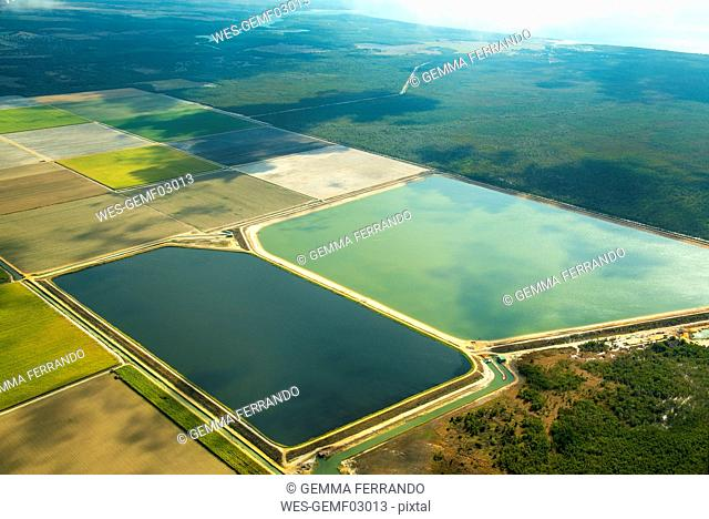 Aerial view of green fields cultivated and two large ponds for watering in Queensland, Australia