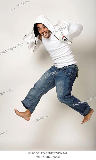 Latin man jumps