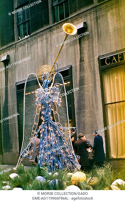 View of a wire sculpture Christmas angel decoration located in the Channel Gardens promenade of Rockefeller Center Plaza, midtown Manhattan, New York City