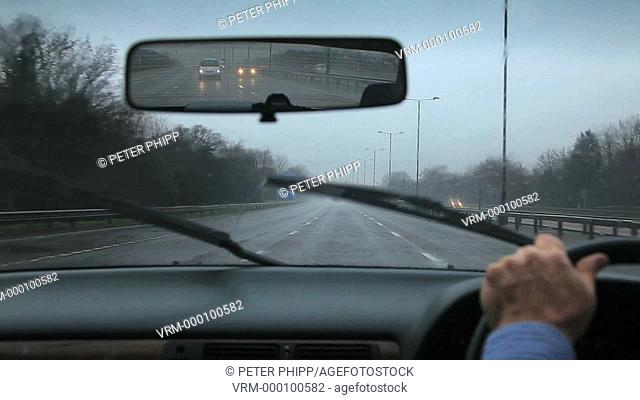 Driving on a rainy wet day with poor visibility and spray on a Motorway
