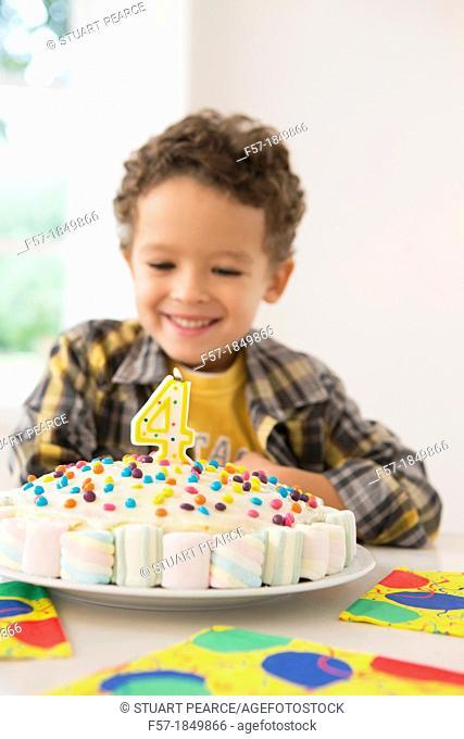 Four year old boy celebrating his birthday