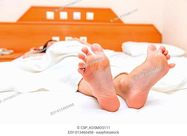 female feet close up stretch themselves upon waking