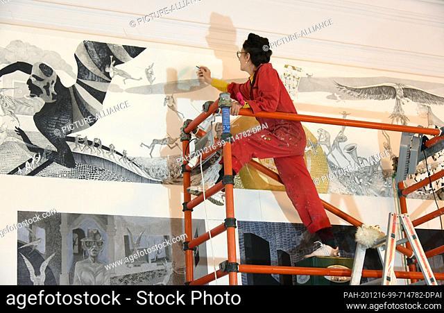 """03 December 2020, Saxony-Anhalt, Merseburg: The Leipzig artist ANTOINETTE finishes her huge Europe artwork """"""""Altar of Europe"""""""" in the Schlossgartensalon of..."""