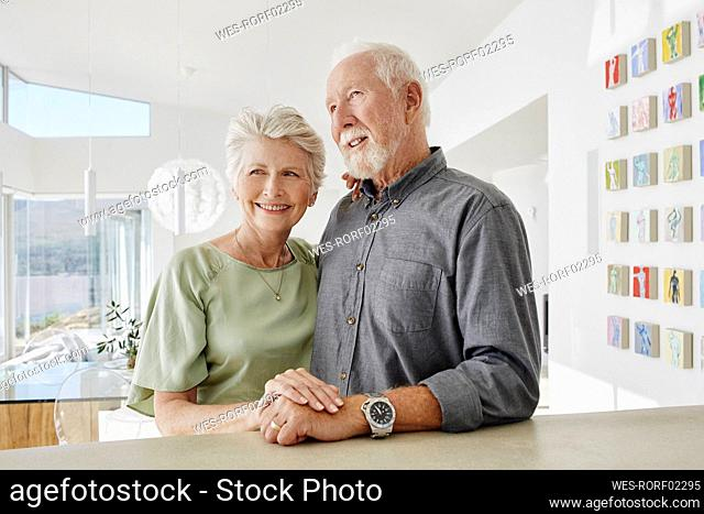 Smiling senior couple in a luxury villa