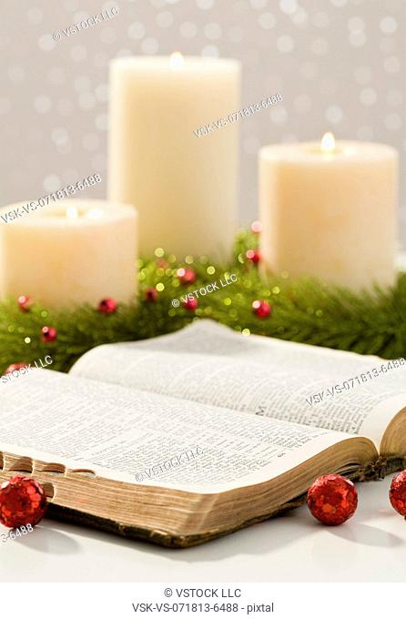 Christmas candles and open bible