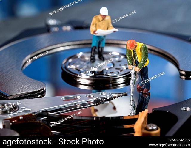 Small mining figurine illustrating concept of artificial intelligence or machine learning using deep data analytics