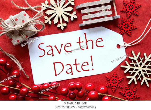 English Text Save The Date. Christmas Decoration Like Gift Or Present, Sleigh. Card For Seasons Greetings With Red Paper Background
