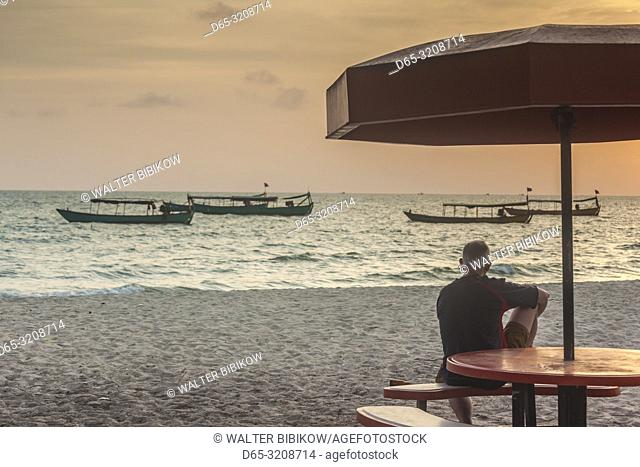 Cambodia, Sihanoukville, street view by Serendipity Beach, boats at sunset, NR