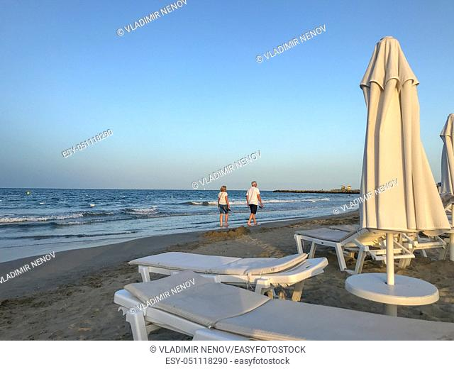 Pomorie, Bulgaria - July 03, 2019: People Relaxing On The Beach