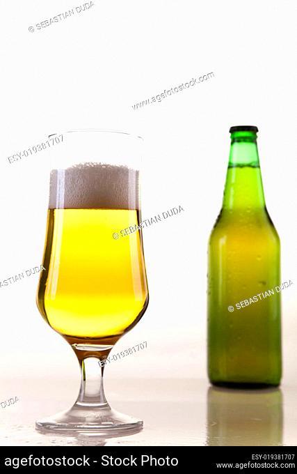 Bottle of beer against a white backgrou