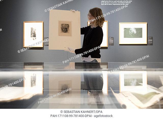 "Restorer Johanna Ziegler holding the lost work by illustrator Kathe Kollwitz, """"Self-portrait with hand on forehead"""", in the Kupferstich-Kabinett ('Collection..."