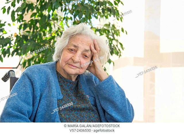 Portrait of elderly woman in the nursing home. Close view