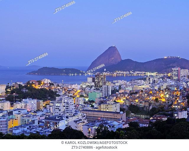 Brazil, City of Rio de Janeiro, Santa Teresa Neighbourhood, Twilight view over Catete and Flamengo towards Sugarloaf Mountain from Parque das Ruinas
