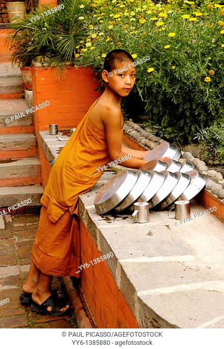 buddhist novice washing dish's, the nepalis , life in kathmandu , kathmandu street life , nepal