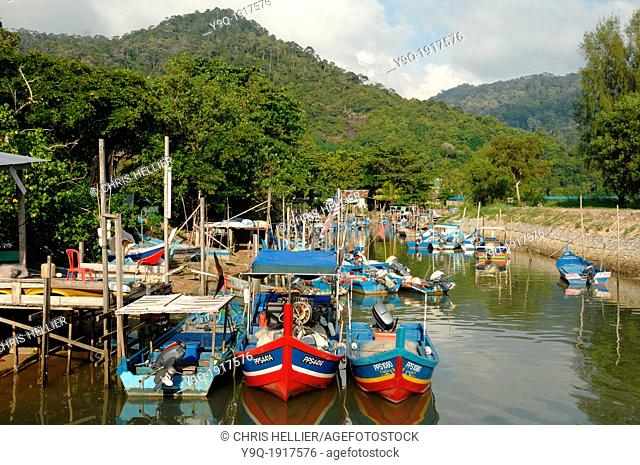 Colourful Fishing Boats in Harbour or Port of Telok Pahang Fishing Village Penang Malaysia