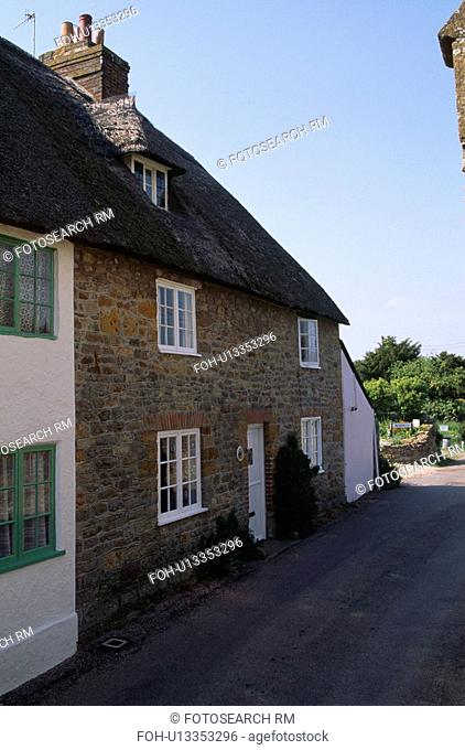 Sideways view of semi detached traditional brick cottage