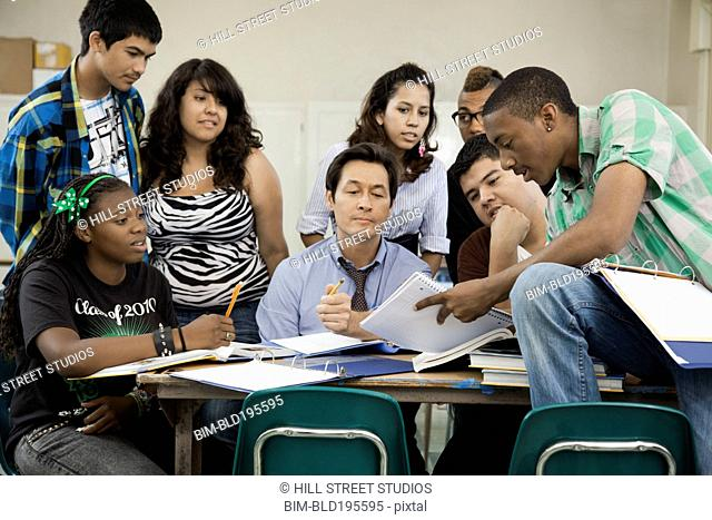 High school students listening to teacher