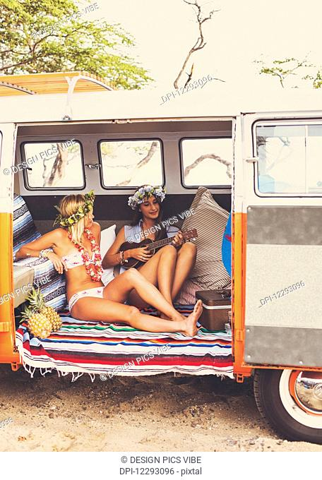 Beach Lifestyle. Beautiful Young Surfer Girls Having Fun Hanging Out In Vintage Surf Van. Best Friends
