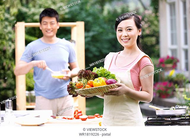 Young couples in the kitchen cooking
