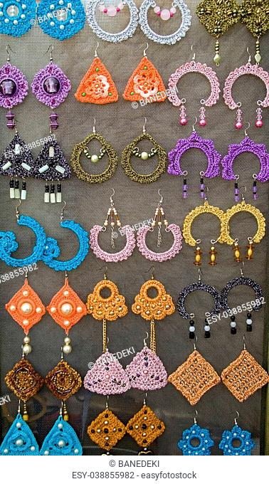 Handmade earrings made of wool and plastic. Photographed in Zrenjanin 27th September 2014
