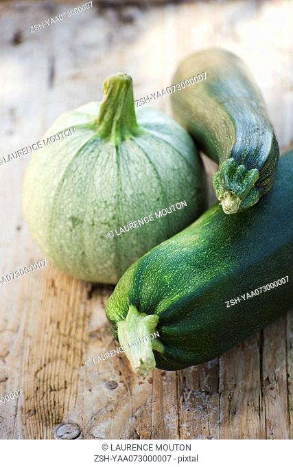 Zucchini and squash on wooden background