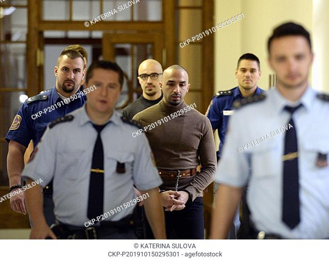 Dutch brothers Arash (centre right) and Armin Nahvi (centre left) are going to a court appearance in Prague, Czech Republic, Tuesday, Oct. 15, 2019
