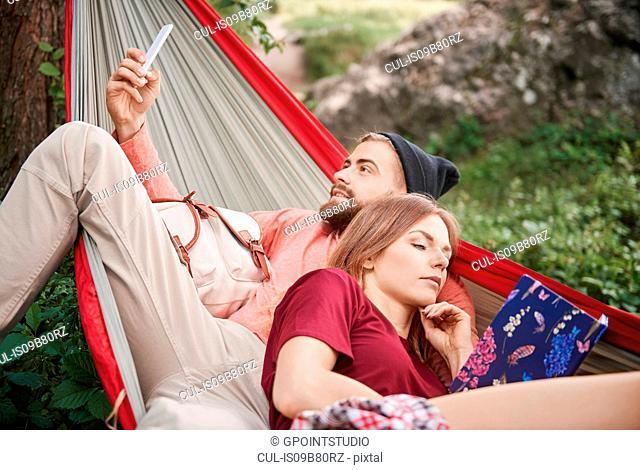 Couple relaxing in hammock, Krakow, Malopolskie, Poland, Europe