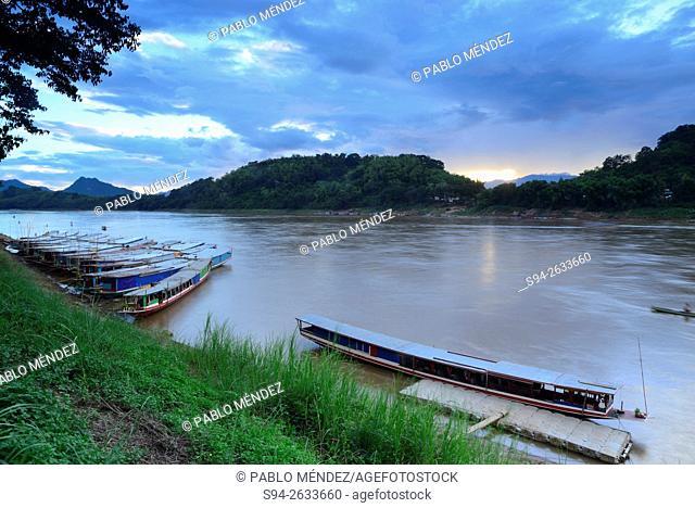 Boat on the edge of Mekong river in Luang Prabang, Laos