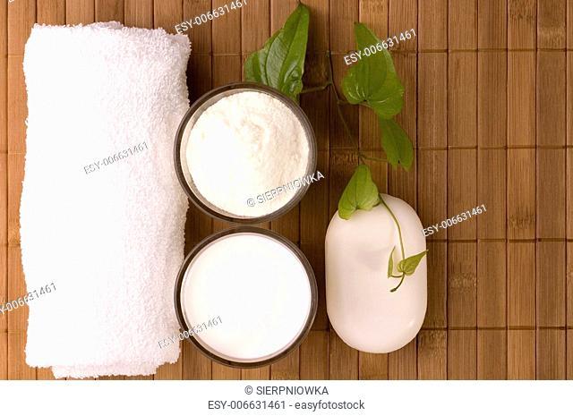milk bath items. soap, milk, towel. white therapy
