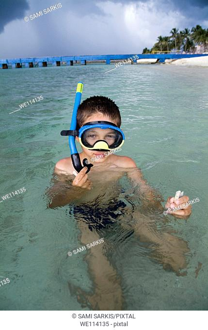 Boy snorkelling in the tropical water at Maria la Gorda beach, Cuba