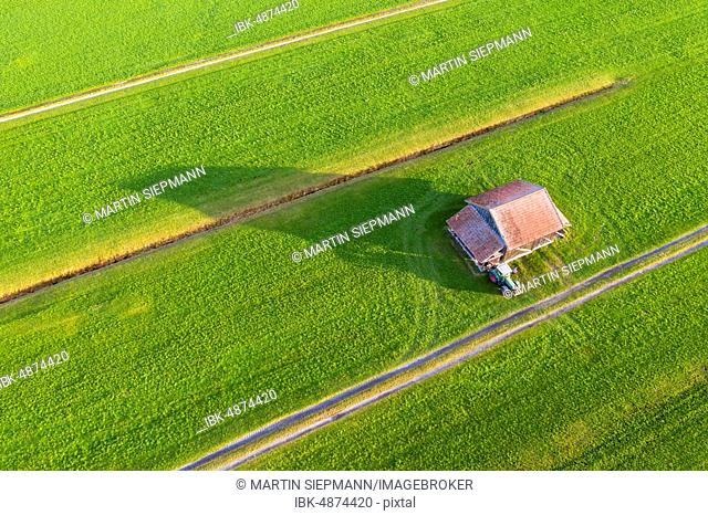 Meadows with barn and tractor, mercenary moss near Schlehdorf, drone shot, Upper Bavaria, Bavaria, Germany