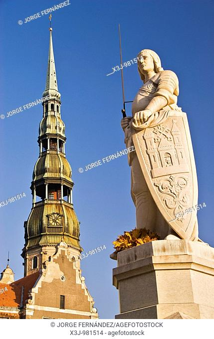 Tower of the St  Peter's Evangelical lutheran church and the statue of Roland in the townhall square of Riga, Latvia, Europe