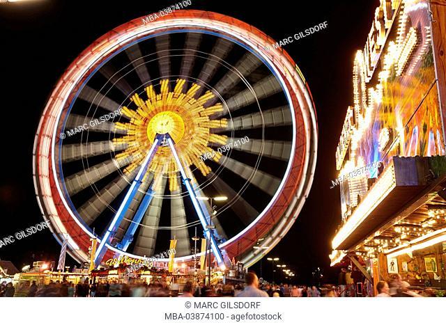 illuminated fairground ride at the Oktoberfest in the darkness