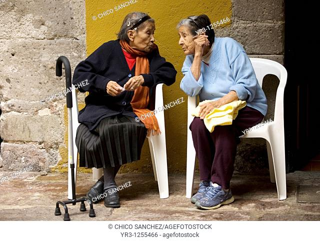 Maria Martinez, 79, left, and Francisca Ruiz, 88, speak in Our Lady of Guadalupe Home for the Elderly, Mexico City