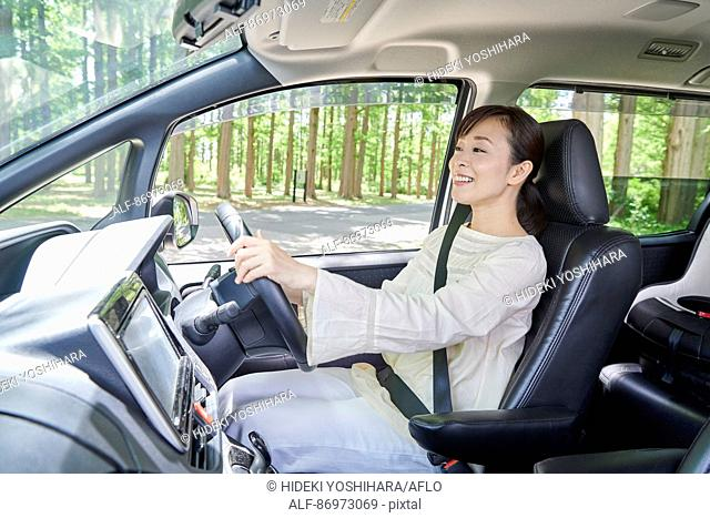 Japanese woman in the car