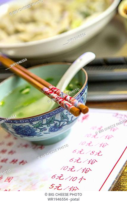 Soup bowl and chopsticks at a Chinese restaurant