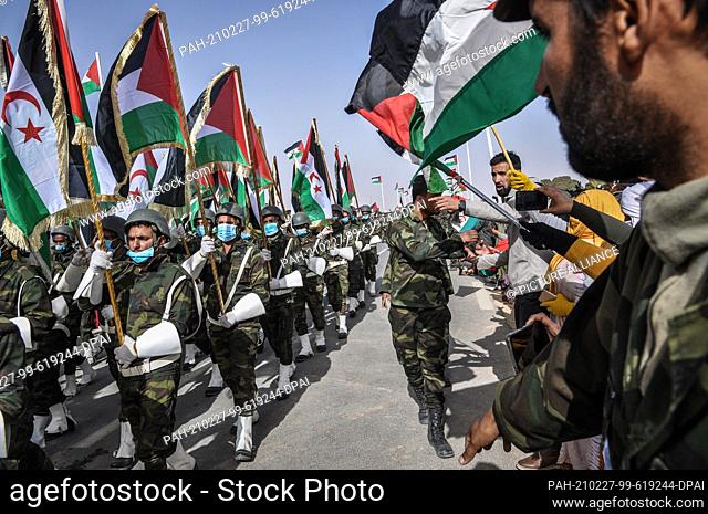 27 February 2021, Algeria, Tindouf: People watch Sahrawi troops parade during celebrations marking the 45th anniversary of the declaration of the Sahrawi Arab...