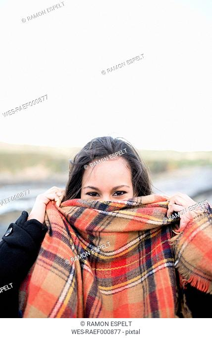 Woman covering her face with a scarf
