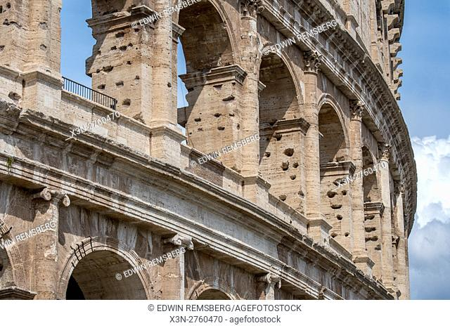 Rome, Italy- View of the famous stone amphitheater known as the Roman Colosseum located east of the Roman Forum. Officially known as the Flavian Amphitheater