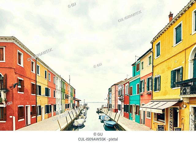 Traditional multi colored houses on canal, Burano, Venice, Italy