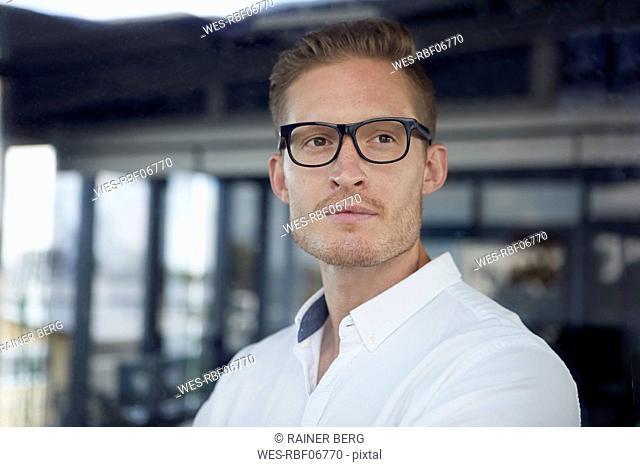 Portrait of confident businessman wearing glasses