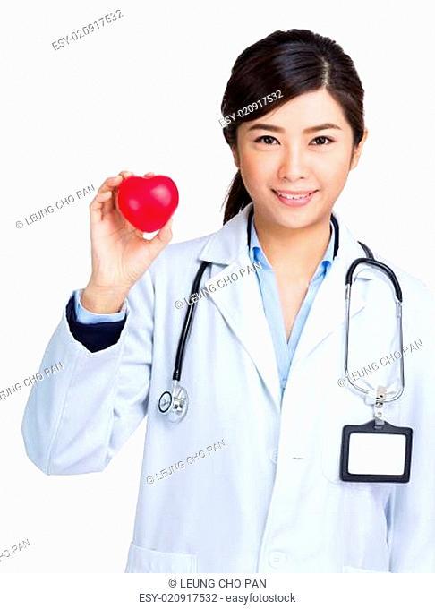 Female doctor holding heart shape ball