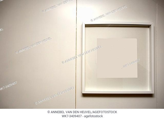 blank frame on a white wall, space for text background texture clean interior